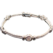 Sterling Silver & Bezel Set Faux Diamonds in Rigid Rope Link Bracelet