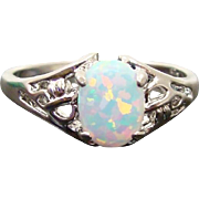 Brilliant Opal Set in Pierced Sterling Silver Ring