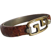 1970's Givenchy Gold Plated Logo Genuine Natural Snakeskin Snap Bracelet- very rare