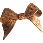 Art Deco Repousse Stamped Arrow pattern Bow Brooch