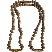 "Vintage Unsigned Wood & Woven Raffia Bead 36"" long Necklace"