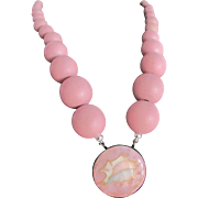 Upcycled Inlaid Conch Pendant With Graduated Pink wooden and White Sponge Necklace