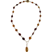 Vintage 9 kt Baltic Natural Carved Amber Wirework Design Pendant with matching 18kt GP Amber Cabochon Clasp