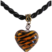 Vintage Art Glass Puffy Black and Amber Swirls Color on Black Silk Cord Pendant
