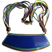 Vintage Unsigned Blue Laminated Curved Cellulose Acetate Centrepiece Pendant with Multi Strand Rainbow Silk Cord Necklace