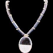 1970's Givenchy Bakelite rod necklace with Enamel & rhinestone Pendant