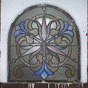 American arched stained glass window inj the original frame