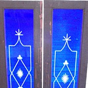 Pair of cobalt blue wheel cut stained glass windows