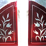 Pair of ruby red wheel cut stained glass windows
