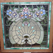 American stained glass  art nouveau window featuring flowers