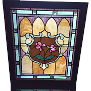 Matched pair of stained glass floral windows