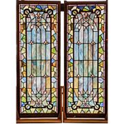 Monumental matched pair of stained glass panels