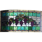 Wonderful cabochon jewels in this hanging grape stained glass window
