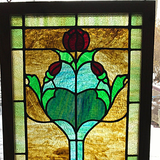 Early 20th century stained glass window featuring rose and rose buds