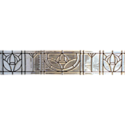 One of a pair of beveled stained glass windows