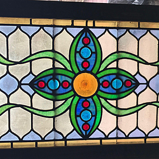 Antique jeweled stained glass window