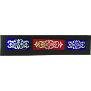 Wheel cut ruby and cobalt stained glass transom window