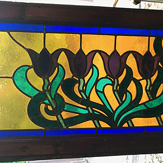 Antique stained glass window featuring tulips