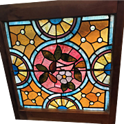 Antique jeweled floral stained glass window