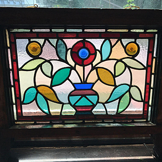 Wonderful Eastlake stained glass window with stylized flower pot