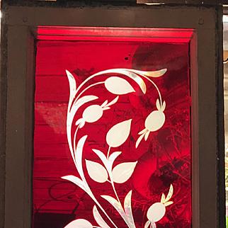 Wonderful ruby red wheel cut stained glass window