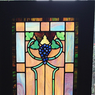 Stained glass cabinet door featuring grapes