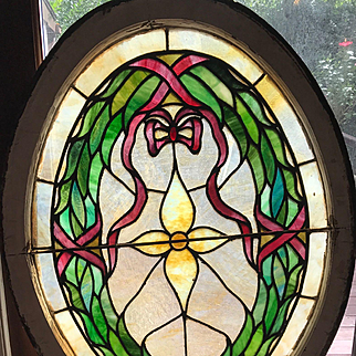 Unusual oval stained glass window