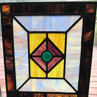 Interesting stained  glass window from the 1920s