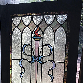 Early flaming torch stained glass window