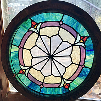 One of a matched pair Circular and beveled stained glass window