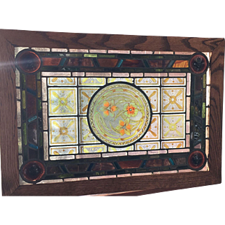 Matched pair of paint and fired stained glass windows