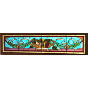 Long antique transom stained glass window