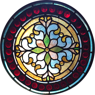 One of a matched pair of jeweled stained glass windows