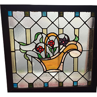 One of a matched pair of flowers in a basket stained glass windows