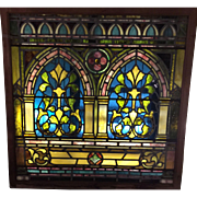 One of a matched pair of Victorian stained-glass windows