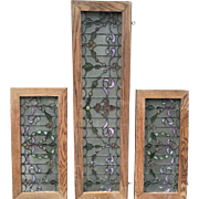 Three piece set of antique stained glass windows