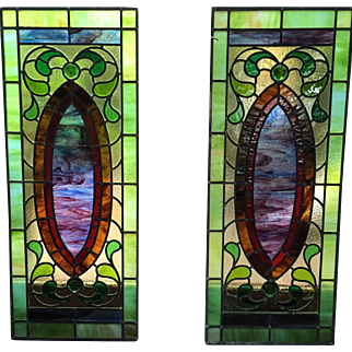 Matched pair of antique stained glass windows
