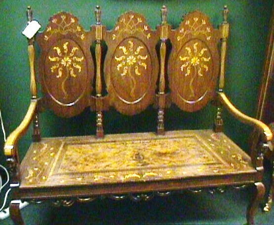 Antique Inlaid Wood Bench with Carved Faces