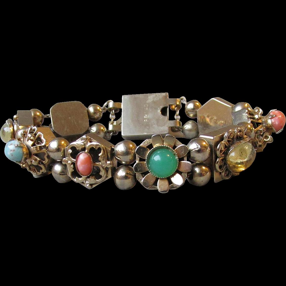 1950 s vintage slide charm bracelet signed reinad from