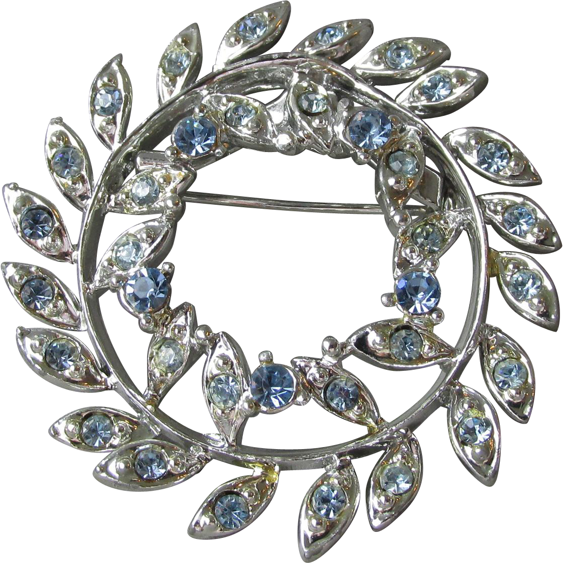 Early 1950's Signed CORO Vintage Pale Baby Blue Rhinestone Silver Tone Rhodium Plated Wreath Pin