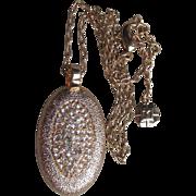 Long MONET Oval Textured Gold Tone Crystal Rhinestone Vintage Pendant Necklace