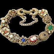Signed GOLDETTE 11 Slide 1960's Vintage Charms Bracelet