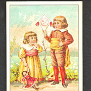 "1880s J. C. Davis' Old Soap Victorian Advertising Trade Card – J.C. Davis & Sons, Boston MA  -  Original ""Smiley Face"" Kite and Doll - 18th C Children"