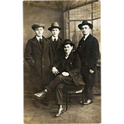 c1915 New York City Photographic Studio Portrait RPPC Real Photo Postcard - New Saint Patrick's Cathedral Faux Window View Backdrop - Young Men Male Friends - Vintage Fedora Hat, Overcoat and Three-Piece Suit Fashion