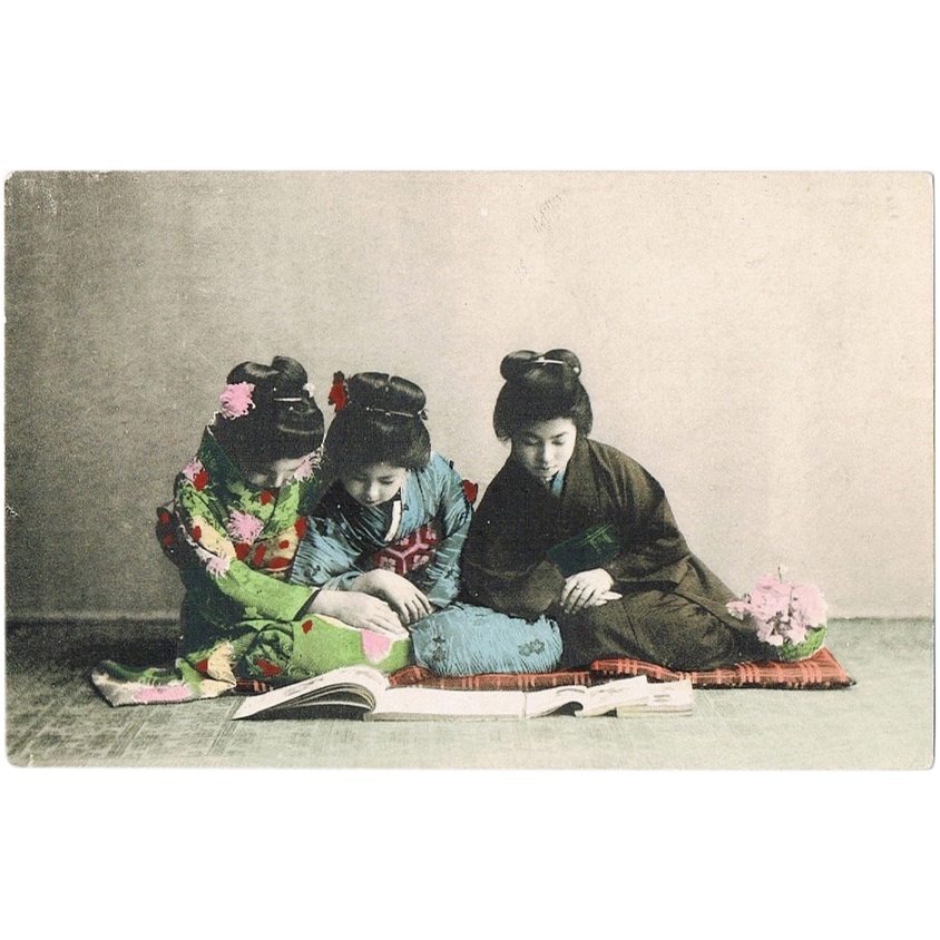 3 Japanese Ladies reading a Book. Tinted Vintage Postcard.