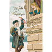 Christmas Postcard with Santa bring a Doll