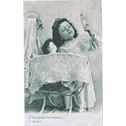 Girl Curing her Doll. Vintage Postcard from 1903