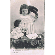 Girl and her sick Doll. Vintage Postcard from 1903