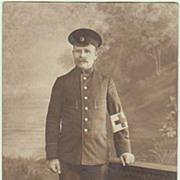 WW1: Soldier with Red Cross Brassard. Vintage Photo.