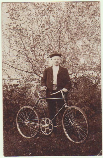 Man with old Bicycle. Vintage Photo. Ca. 1920